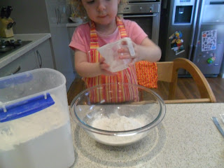 Measuring flour into a bowl for muffin recipe