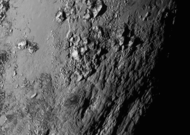 Photograph by New Horizons of a range of youthful mountains on Pluto