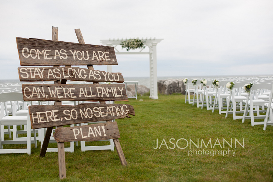 Rustic wedding sign on wood planks: Come as you are. Stay as long as you can. We're all family here. So no seating plan! Door County wedding on Lake Michigan. Photo by Jason Mann Photography, 920-246-8106, www.jmannphoto.com