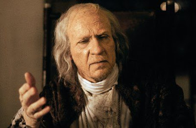 Aging Antonio Salieri confesses his tale to the young priest, played by F. Murray Abraham, 1984 musical, Directed by Milos Forman