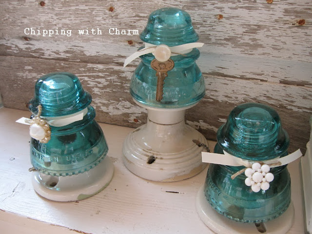 Chipping with Charm: Aqua Glass Insulator Trees...http://chippingwithcharm.blogspot.com/