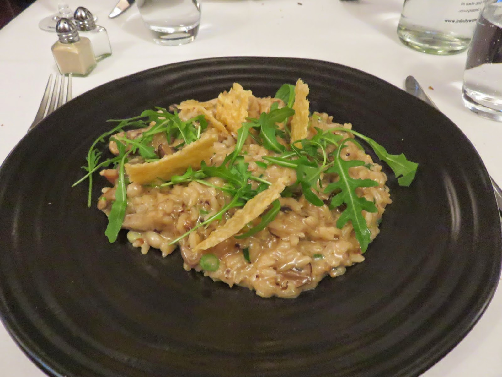 wild mushroom risotto with marscapone, parmesan crisp and a garnish of wild rocket