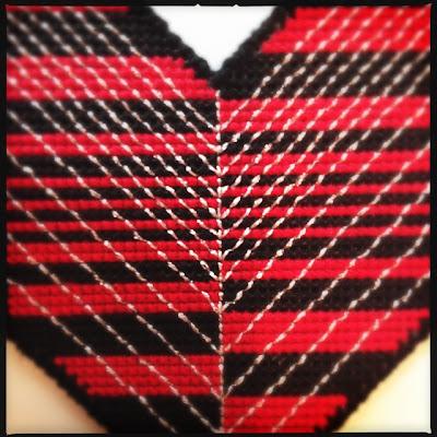 Embroidered geometric necklace made from plastic canvas. Broderet geometrisk halskæde af plastik kanvas.