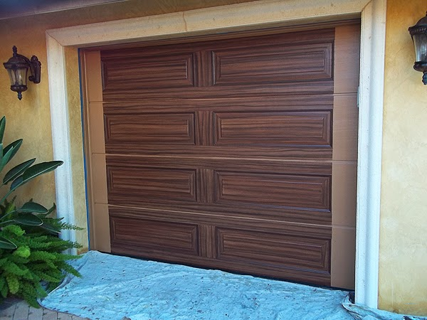 Painting two garage doors to look like wood grain for Paint garage door to look like wood
