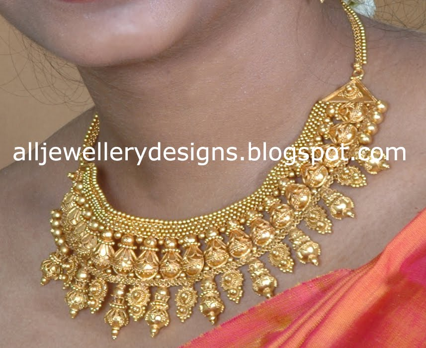 Jewellery Designs: Traditional Gold Necklace and Jhumka Earrings Set