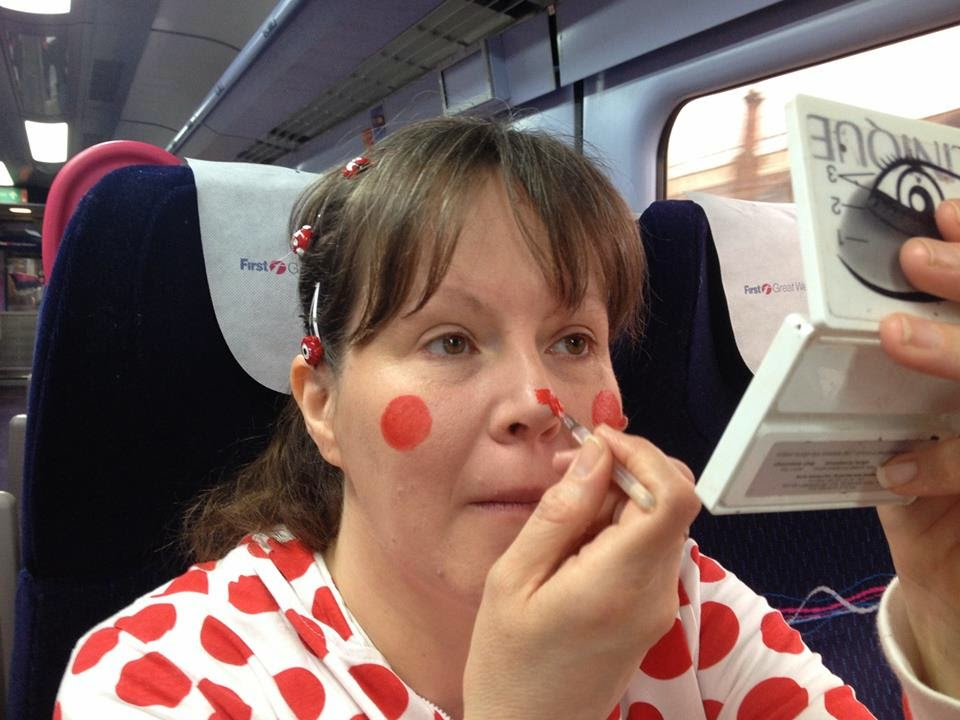 Painting on a red nose for red nose day 2015