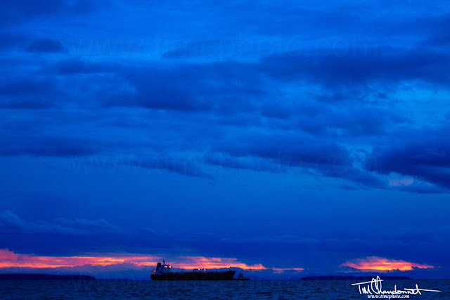 Tim Chandonnet Photography,Bellingham Washington Photographer, oil ship,boat,Cherry Point, Refinery,reflling, Salish Sea, North  Puget Sound, industry, industrial photography, oil industry, big oil, sunset, islands, colorful, nightfall, clouds, stormy