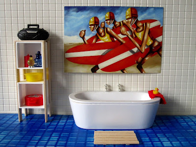 Modern dolls' house miniature bathroom with wooden duck-board bath mat.