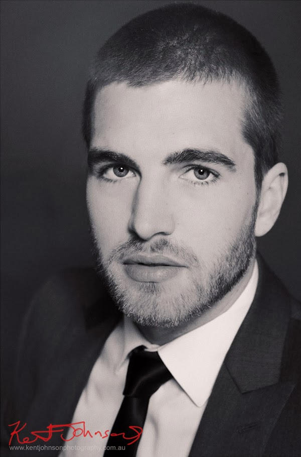 Headshot, suit jacket white shirt and black tie, unshaven - Evan, Male Modelling Portfolio photographed by Kent Johnson.