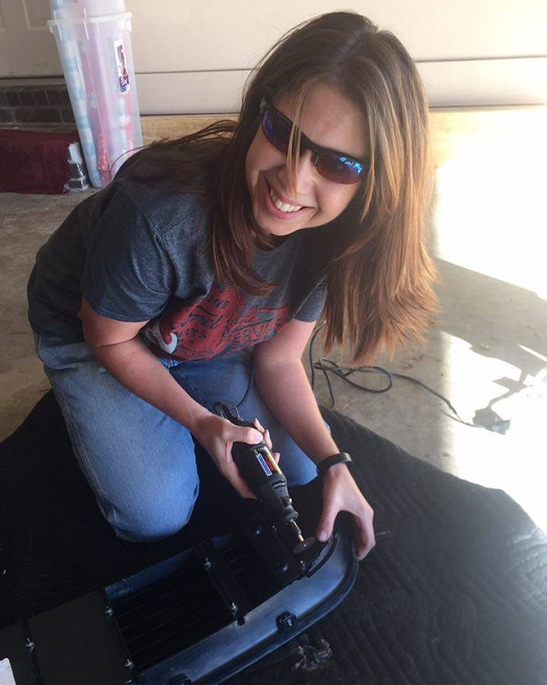 Shannon working on her Ford Mustang