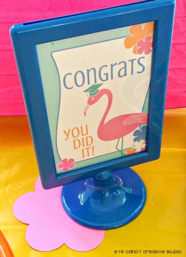 congrats grad sign, flamingo, grad cap, blue IKEA frame, luau grad party