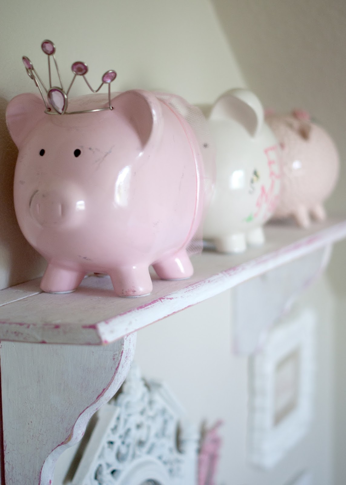 Piggy banks and shelf