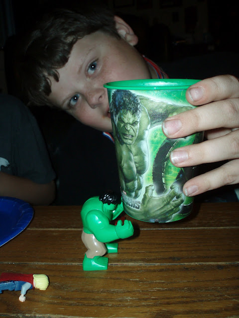 Toy Hulk lifting Hulk Cup