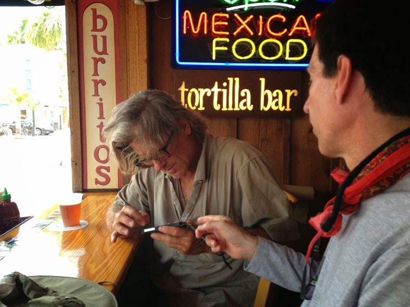 Mike checking out Paul's iPhone photos at Amigos Tortilla Bar