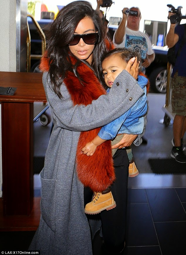 Sweet Mother! Kim Kardashian Shields Her Daughter, North From The Paparazzi – Photos