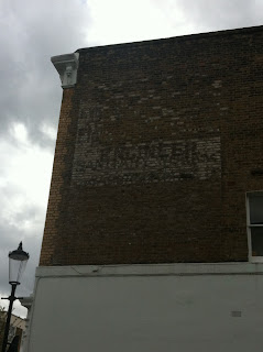 Ghost sign on St. Charles Square, London W10