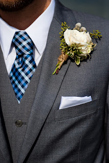 fall boutonniere with berries and twine