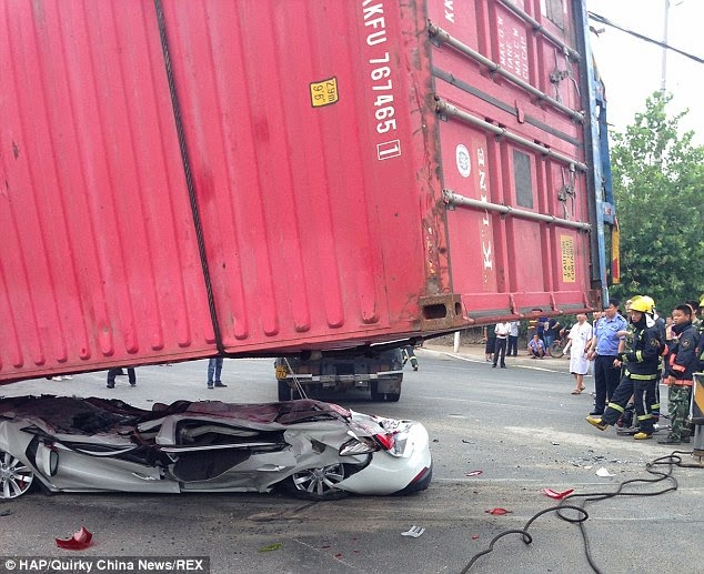 http://www.dailymail.co.uk/news/article-2704093/Crash-victims-miraculously-survive-thumbs-car-crushed-flat-lorrys-shipping-container-load.html
