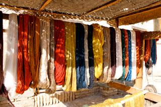 Silk thread skeins in Khiva Silk Carpet workshop courtyard