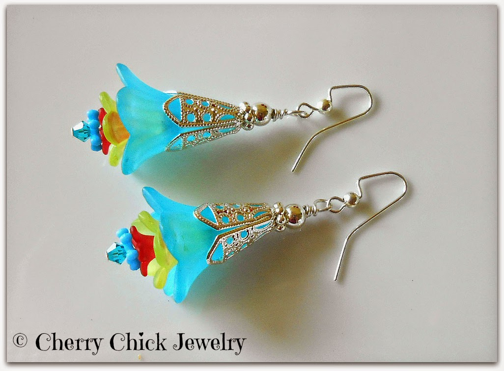 http://www.cherrychickjewelry.com/product/lucite-flower-victorian-earrings-aqua-blue-yellow-red-swarovski-crystals