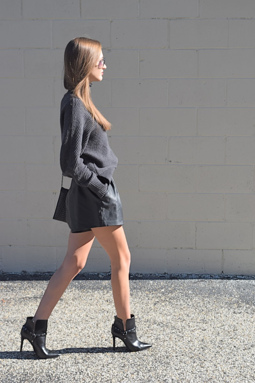 wearing loft fire chunky knit sweater, faux leather shorts, bcbgeneration black studded booties