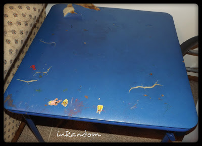 touching up a table with chalkboard decals