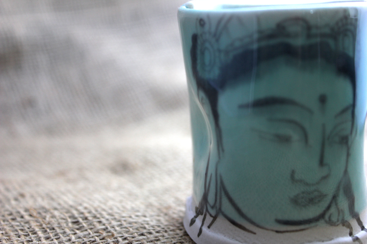 porcelain tea bowl with hand painted buddha face