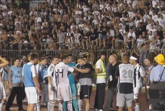 A Partizan Ultras leader Miloš Radisavljević Kimi removes the captain armband off Marko Šćepović