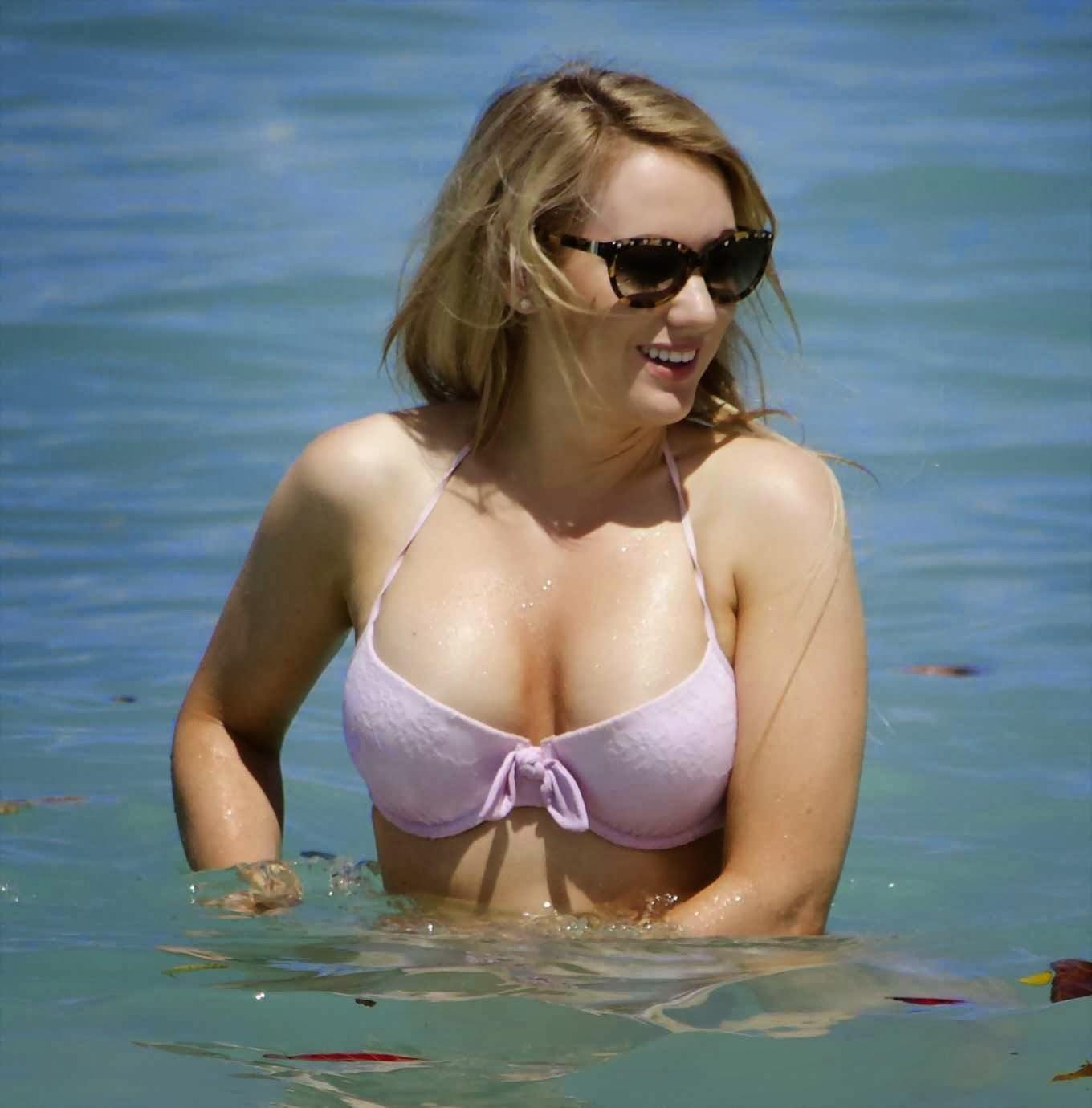 Rebecca Ferdinando wearing bright pink string bikini at the beach in Barbados