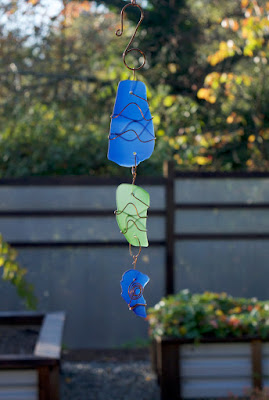 Blue and green glass sun catcher with copper, handcrafted by Coast Chimes