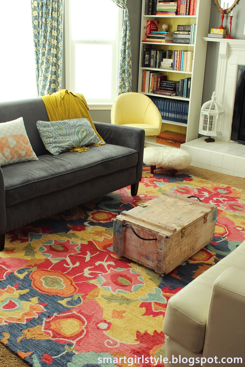 so i moved the old dining room rug into the living room after some
