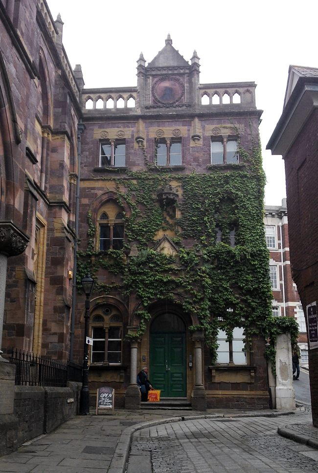 cute ivy covered building cobblestone street pretty
