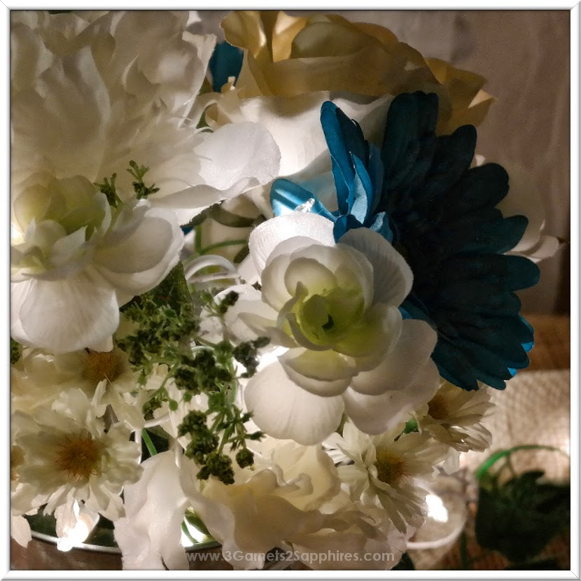 White lights in artificial floral arrangement