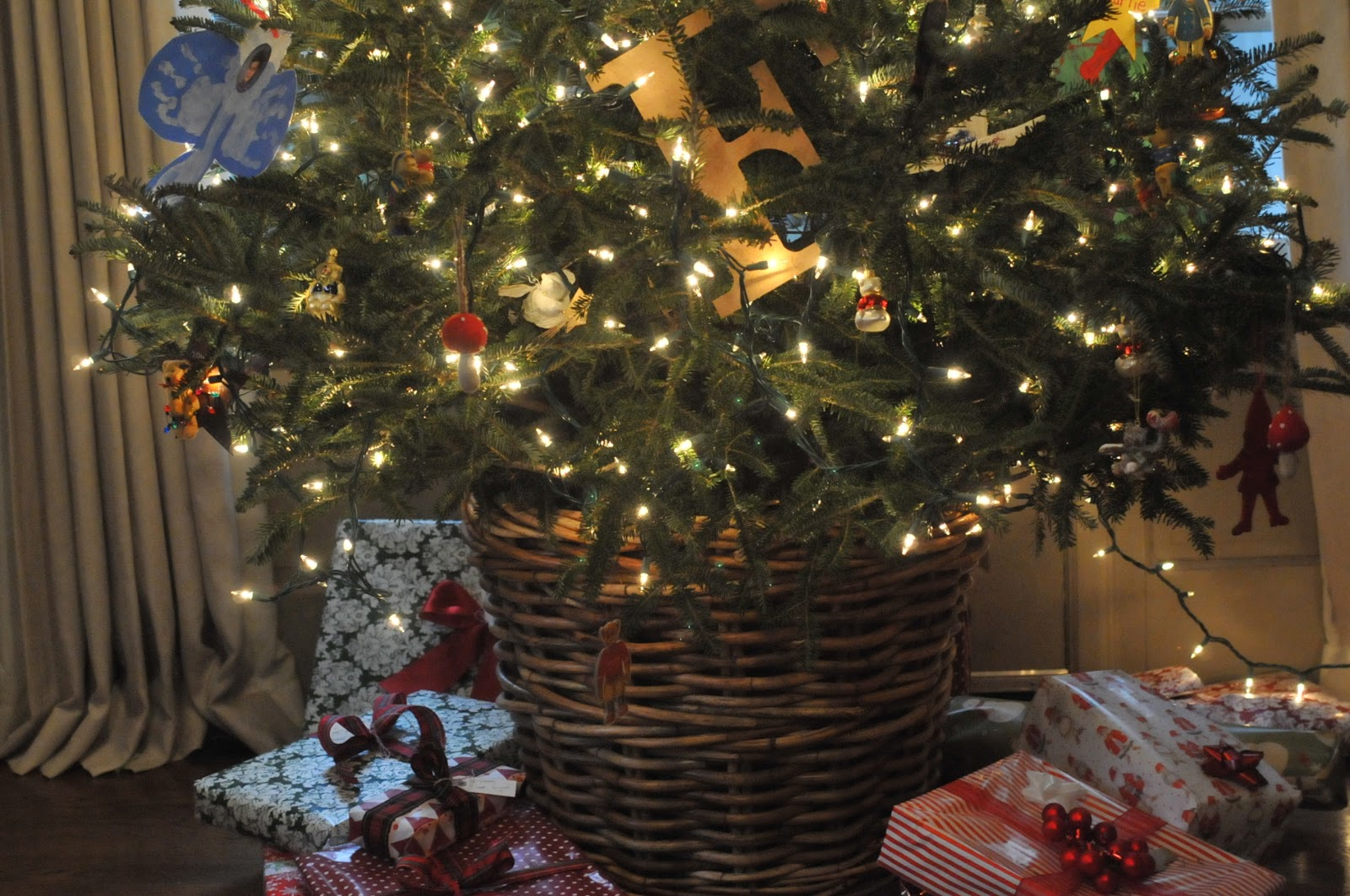 nine sixteen putting a fresh christmas tree in a basket