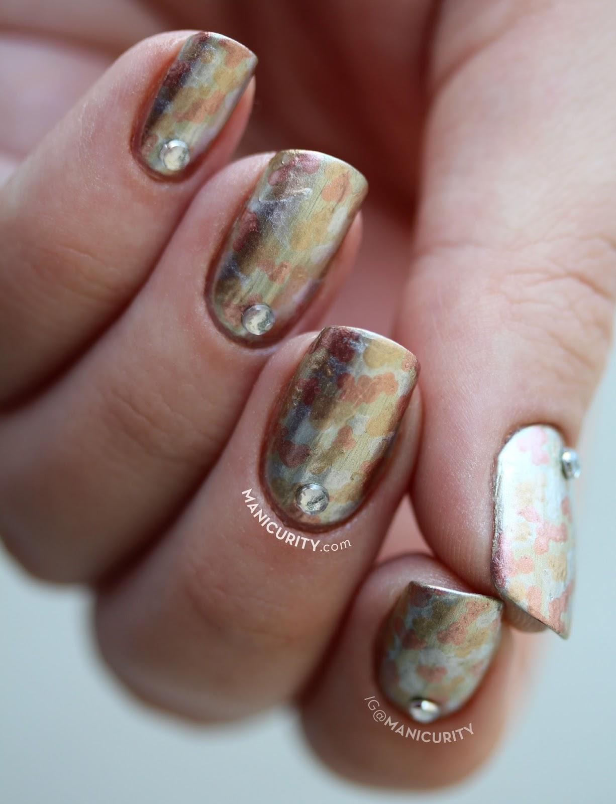 The Digit-al Dozen: Mokume-gane Nail Art - looks like chrome camo nails or metallic wood grain nails | Manicurity.com