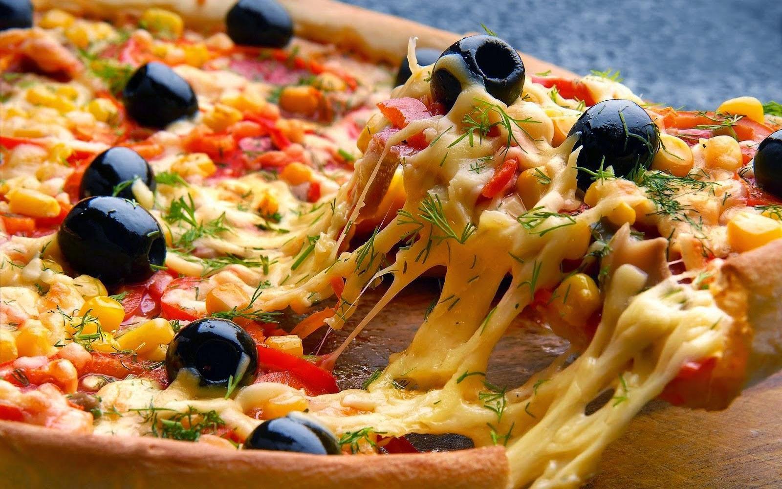 Comer pizza diminui a chance de ter câncer.