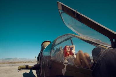 woman inside of plane, vintage tiger shark airplane, fashion photographer los angeles