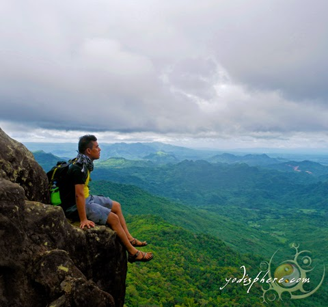 Mountaineer enjoying the heights and the view at Mt. Pico de Loro summit  hover_share