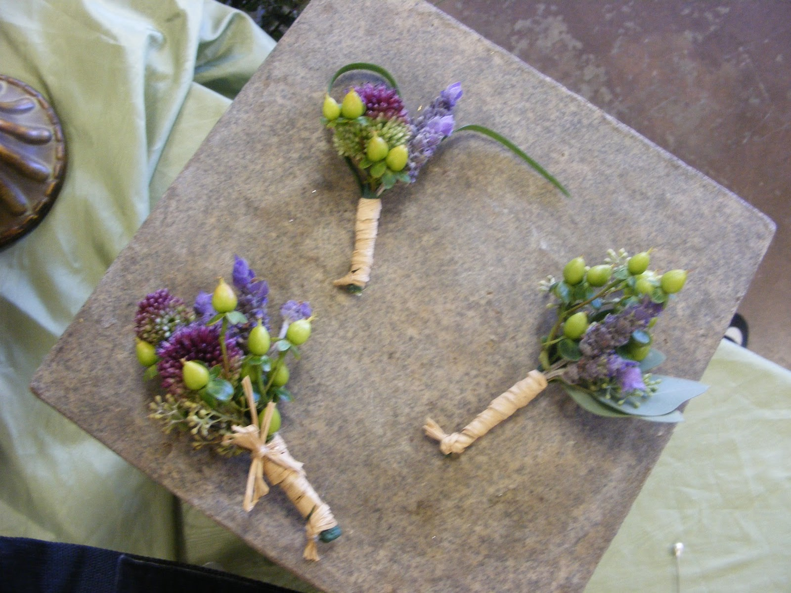 ... for his groomsmen. Each boutonniere was finished with a raffia wrap