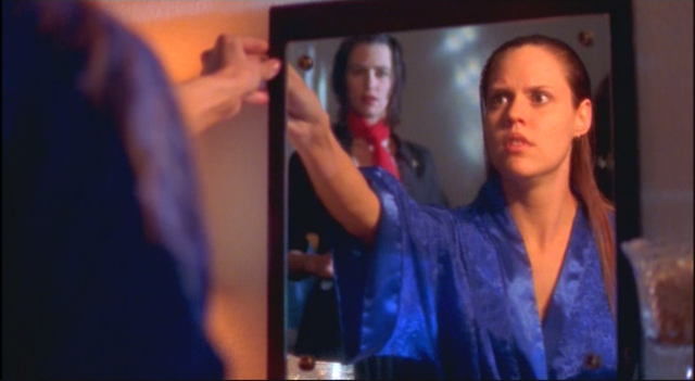 AMERICAN NIGHTMARE (2002): Misty sees Jane is lurking behind her in the mirror's reflection