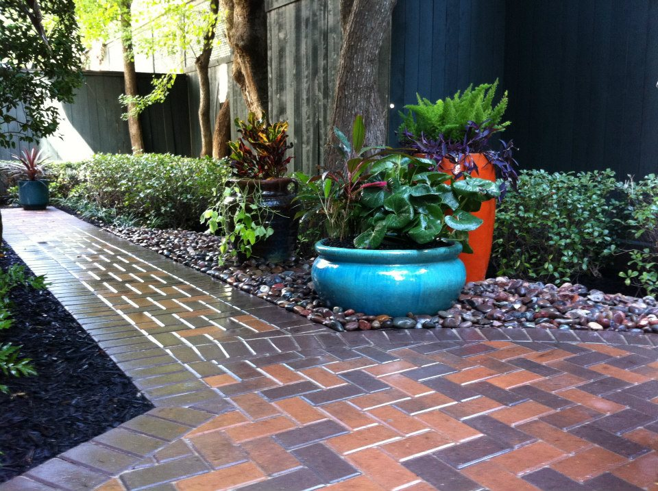 Laird landscaping inc adding beautiful potted plants to for Landscaping with potted plants