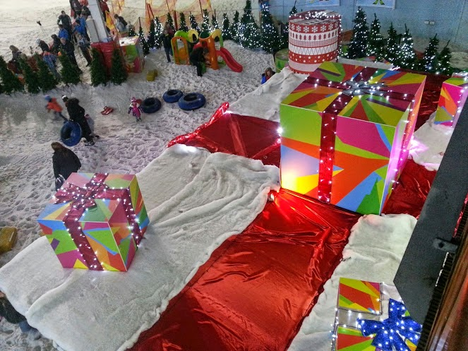 Santa's grotto decorated as a giant present