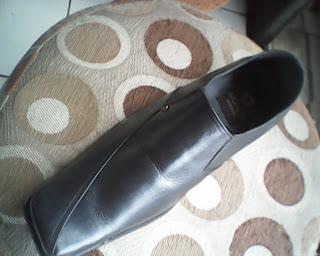 sepatu aigner yang utama