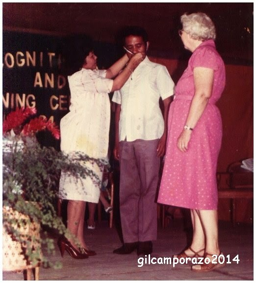 Gil receiving academic honor medal from college prexy Valera while Sister Kent looking on.