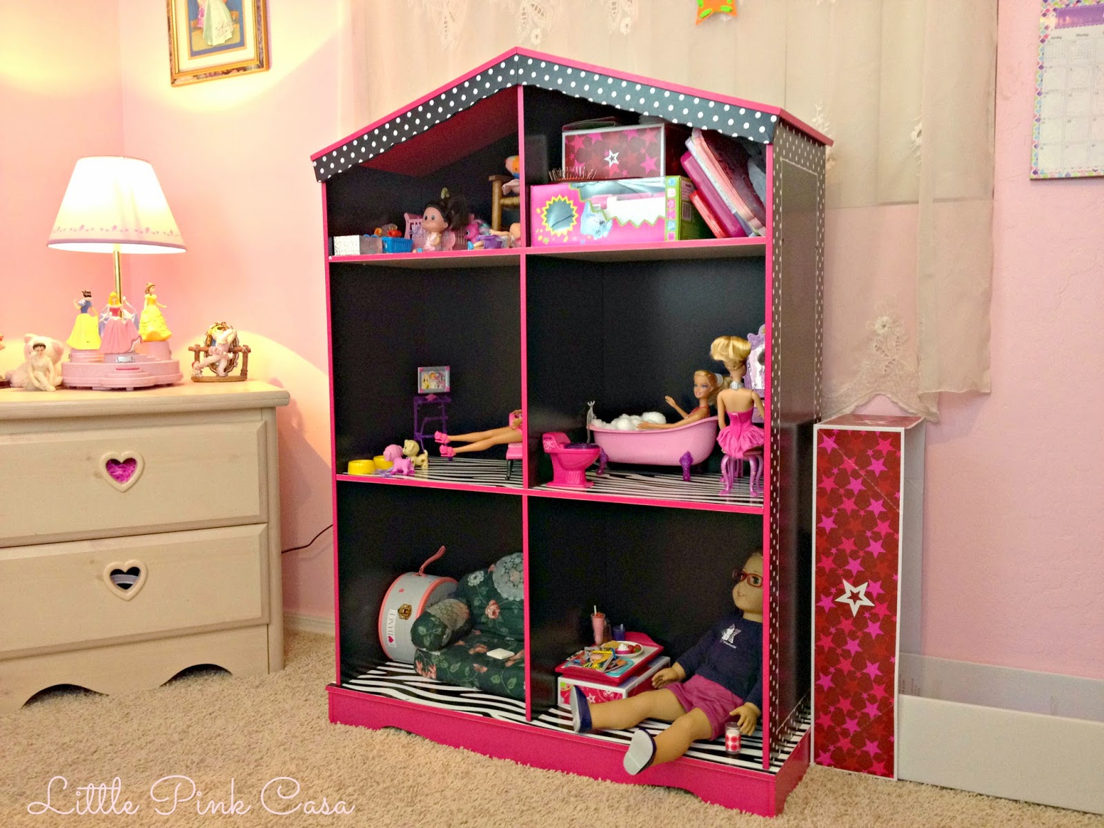 American girl doll little pink casa one happy girl with a new doll house solutioingenieria Choice Image