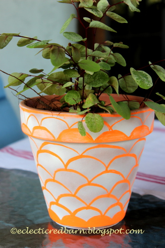 Ceramic pot decorated with chalk markers