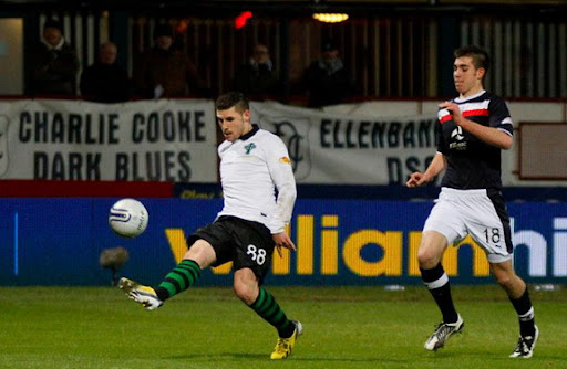 Celtic player Gary Hooper lobs the ball over Robert Douglas to score the second of the match