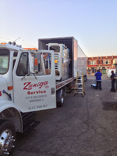 Load-transfer-unload-semi-truck-flatbed-tractor-skid-loader