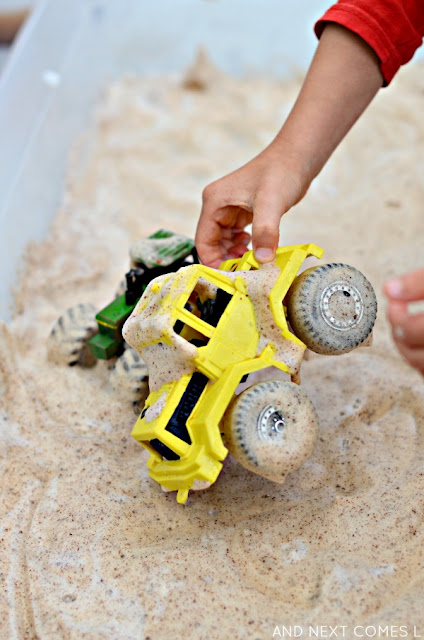 Messy sensory play idea for kids using cinnamon soap foam and tractors from And Next Comes L