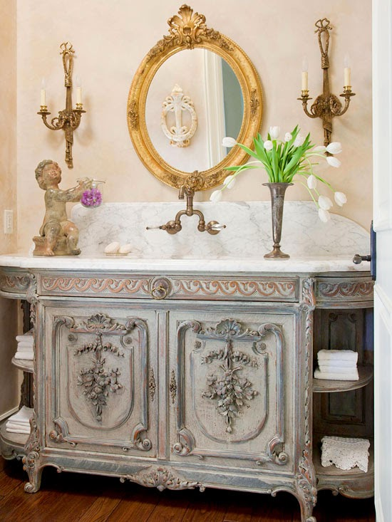 candlestick sconces candlestick wall sconces ornate details and cabinets are a nod to country french style keep in mind that decorative